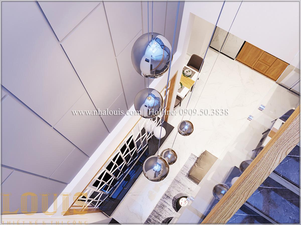 Phòng khách Mẫu thiết kế nhà phố 5 tầng tại Tân Bình với không gian thiên nhiên xanh mát - 12