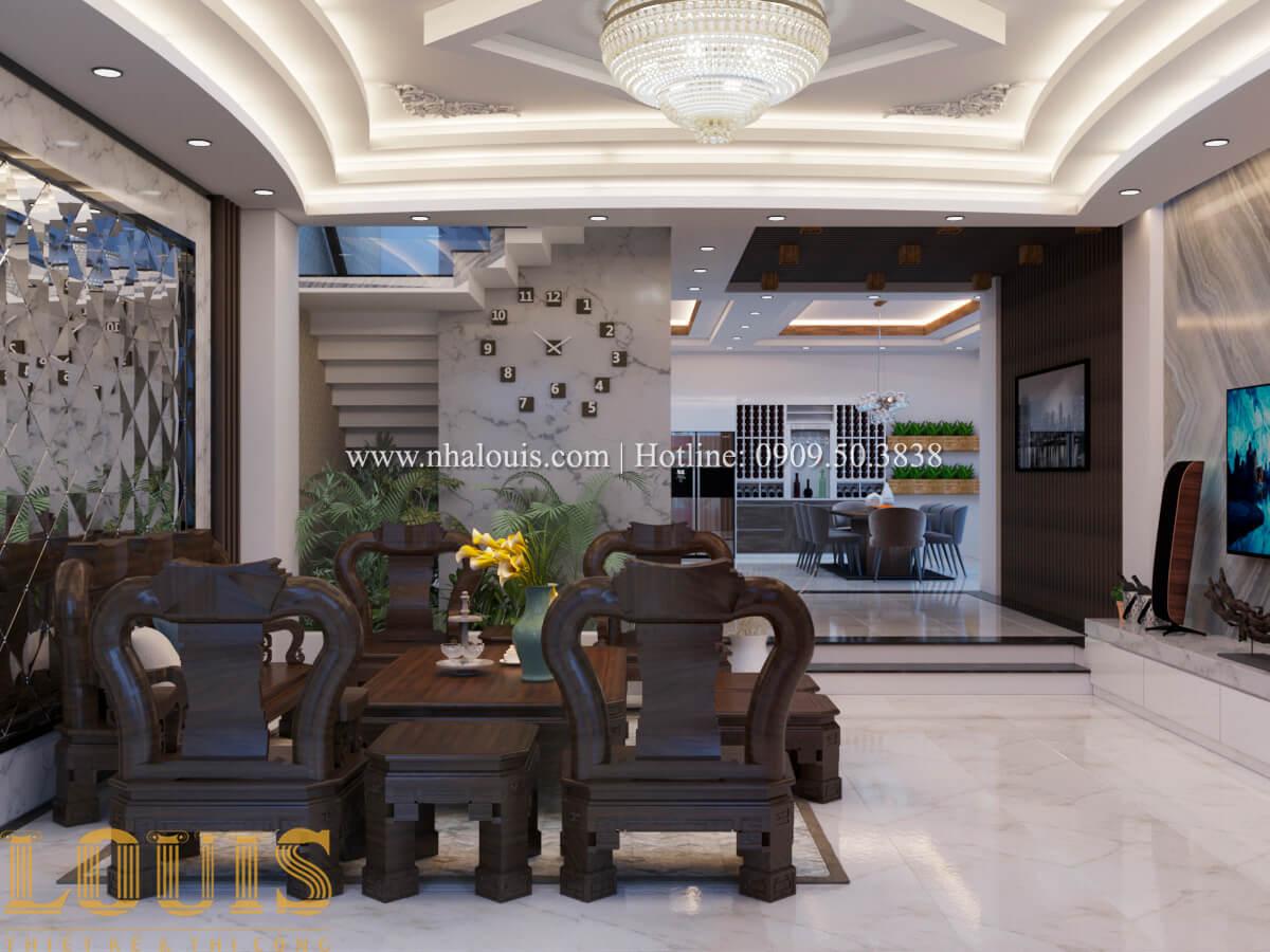 Phòng khách Mẫu nhà phố bán cổ điển với mái Thái độc đáo tại Tân Bình - 07